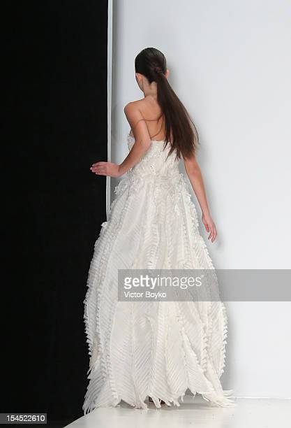 A model stumbles on the runway at the Kai Spring/Summer 2013 show on day 4 of MercedesBenz Fashion Week Russia Spring/Summer 2013 at Manege on...
