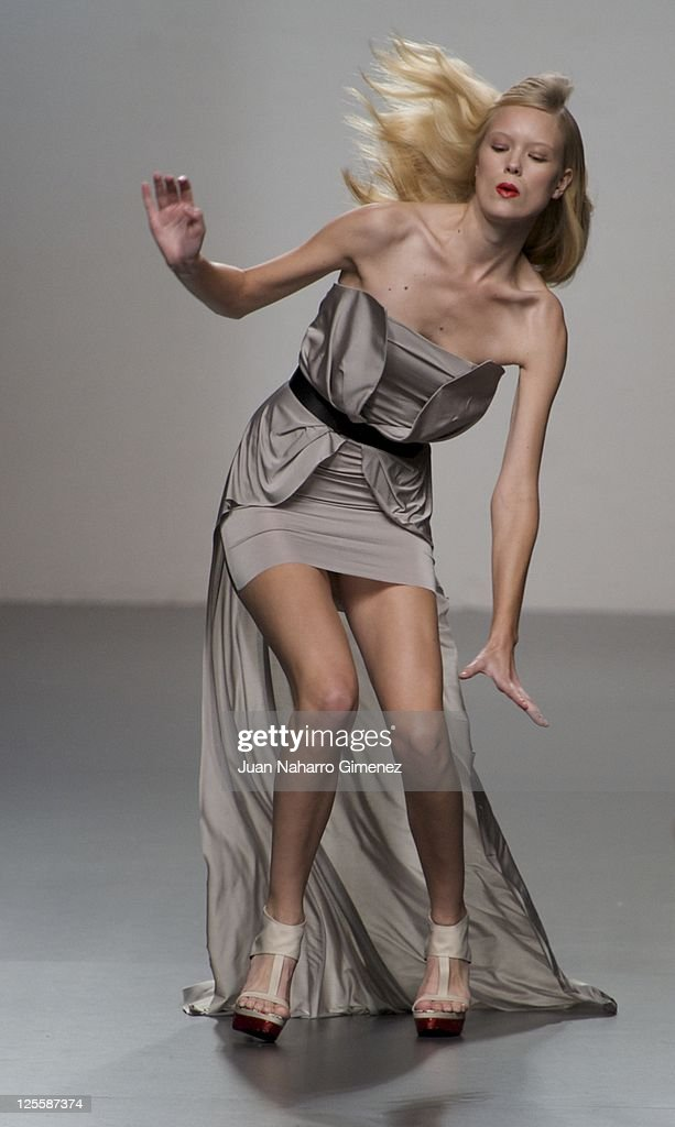A model stumbles walking the runway in the Amaya Arzuaga fashion show during the Cibeles Madrid Fashion Week Spring/Summer 2012at Ifema on September 18, 2011 in Madrid, Spain.