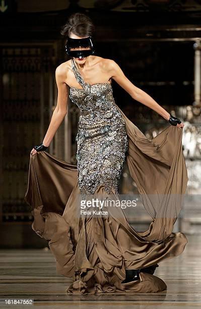 A model stumbles while walking the runway at the Ashley Isham show during London Fashion Week Fall/Winter 2013/14 at Freemasons Hall on February 16...