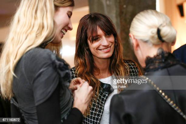 Model stylist and blogger Veronika Heilbrunner French Model Caroline de Maigret and Vogue Germany chief editor Christiane Arp during the Chanel popup...
