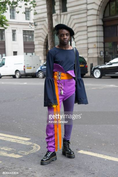 Model stylist and dancer Ramario Chevoy wears Maison Mason trousers and belt Cow vintage hat and bag own design top and Doc martens boots on day 1 of...