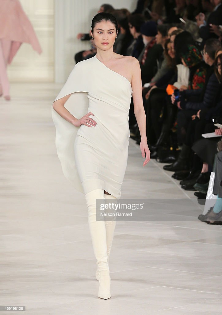 Model Sui He walks the runway at the Ralph Lauren fashion show during Mercedes-Benz Fashion Week Fall 2014 at St. John Center Studios on February 13, 2014 in New York City.
