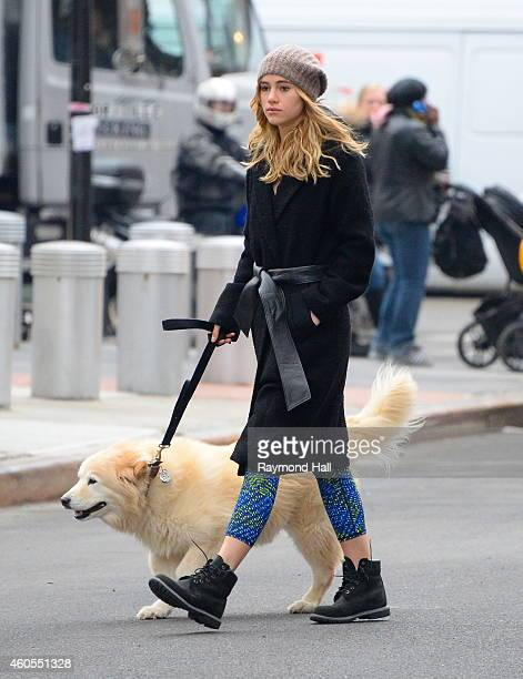 Model Suki Waterhouse is seen walking her Dog in Soho on December 16 2014 in New York City