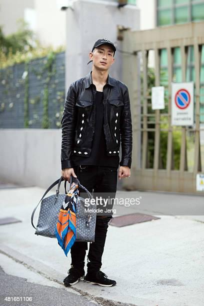 Model Sungjin Park exits the Bottega Veneta show in a W Hotels hat Saint Laurent jeans Visvim shoes and a Goyard bag on June 21 2015 in Milan Italy