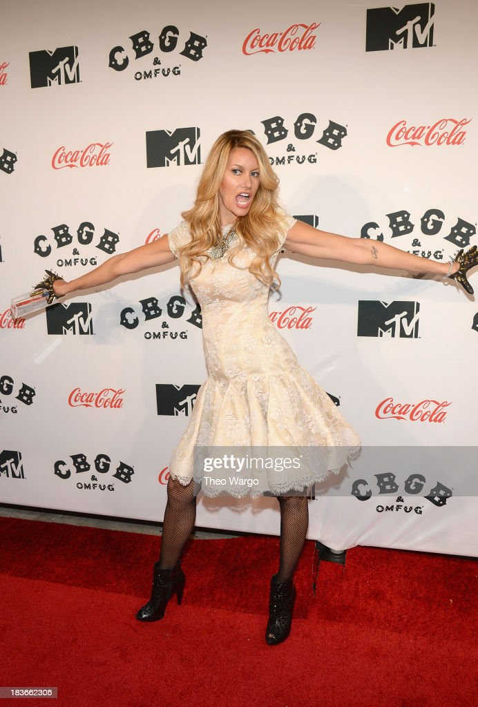 Model Susan Holmes-McKagan attends the Premiere of 'CBGB: The Movie' during the CBGB Music & Film Festival 2013 at Landmark Sunshine Cinema on October 8, 2013 in New York City.