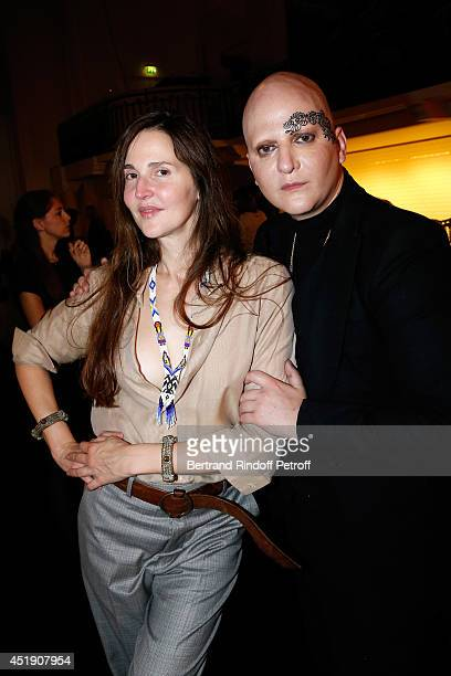Model Suzan and Photographer Ali Mahdavi pose after the Jean Paul Gaultier show as part of Paris Fashion Week Haute Couture Fall/Winter 20142015 Held...