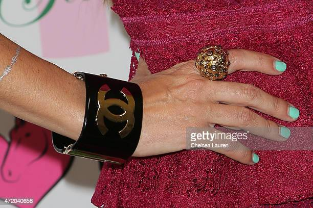 Model / swimwear designer Susan Holmes McKagan jewelry detail arrives at the 2nd Annual How2Girl Kentucky Derby Ladies Luncheon on May 2 2015 in...