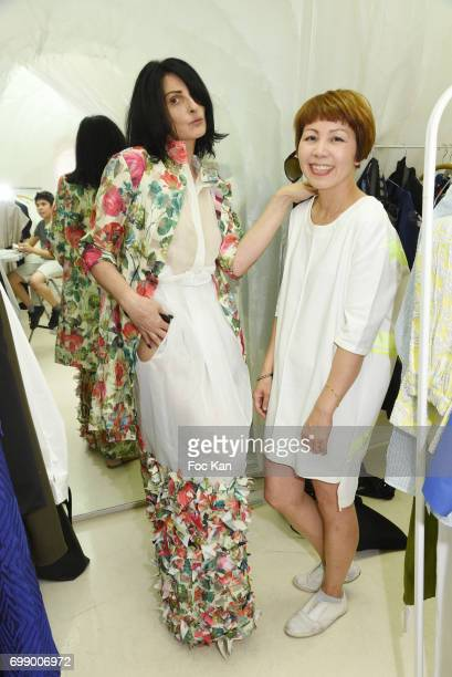 Model Sylvie Ortega Munos and designer Ken Okada attend Ken Okada Yellow Carpet Street Show Rue de La Chaise As Part of Faubourg Saint Germain...