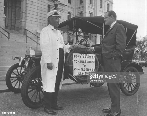 Model T Express Ready for Deliver Patrick Murphy Gov John Love's press secretary hands a letter of greeting to Martin Krusnik of 2709 S Cook St who...