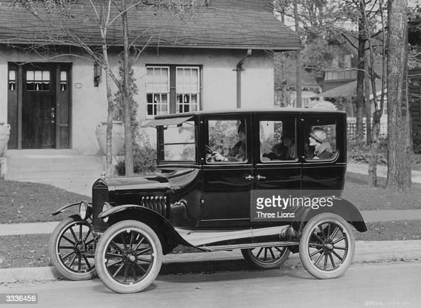 A model 'T' Ford motorcar outside a suburban house