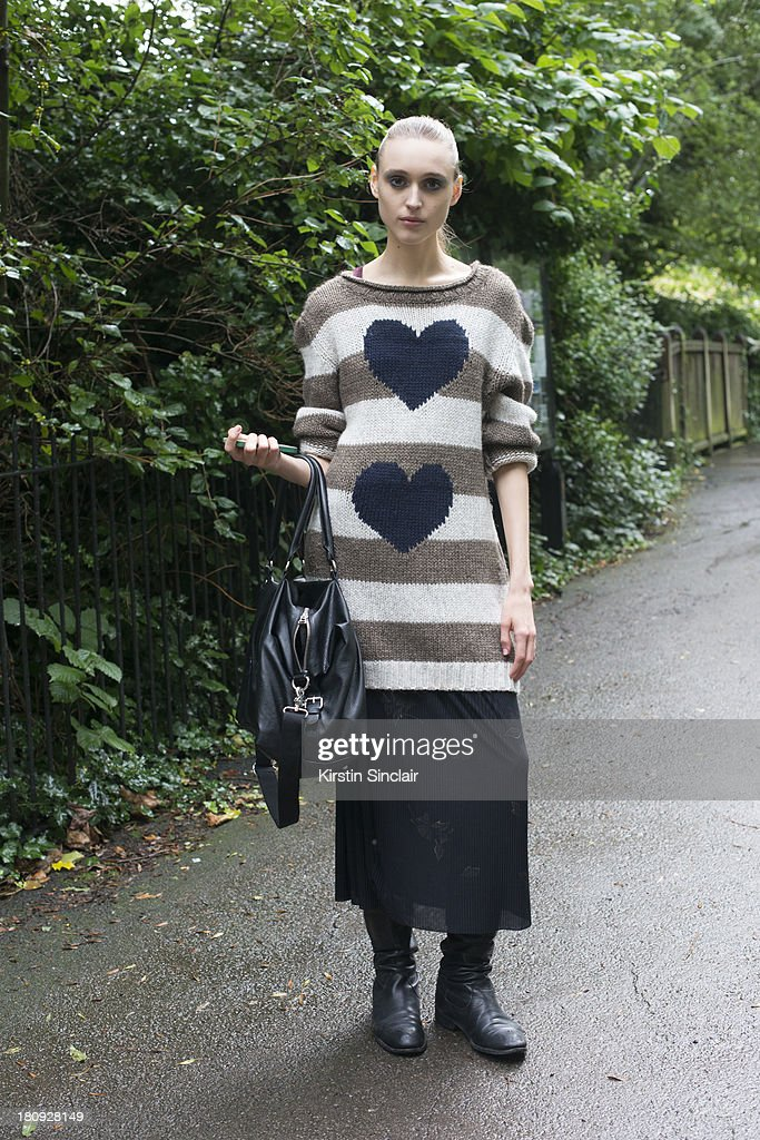 Model Tabea Weyrauch wears an Antoni and Alison jumper, H and M bag and a vintage skirt on day 5 of London Fashion Week Spring/Summer 2013, at Somerset House on September 17, 2013 in London, England.