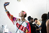 A model takes a selfie backstage at the Jill Stuart SS16 show part of New York Fashion week at Industria Studios on September 12 2015 in New York City