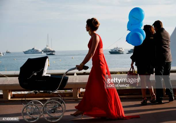 A model takes part in a photoshoot on the Croisette during the 68th Cannes Film Festival in Cannes southeastern France on May 19 2015 AFP PHOTO /...