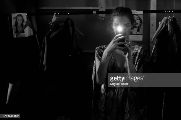 A model takes pictures at the backstage during the Pineda Covalin show as part of the Mercedes Benz Fashion Week Mexico A/W 2017 at Monumento a la...