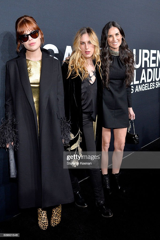 Model Tallulah Willis, Scout Willis and actress Demi Moore, in Saint Laurent by Hedi Slimane, attend Saint Laurent at the Palladium on February 10, 2016 in Los Angeles, California for the Saint Laurent Los Angeles show.