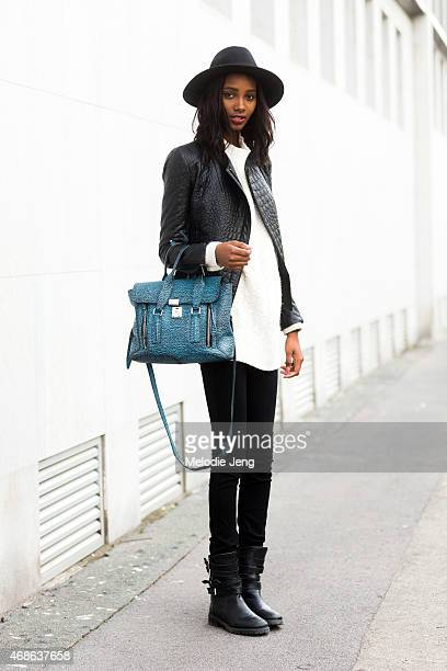 Model Tami Williams exits the Bottega Veneta show with a 31 Phillip Lim bag on Day 4 of Milan Fashion Week FW15 on February 28 2015 in Milan Italy