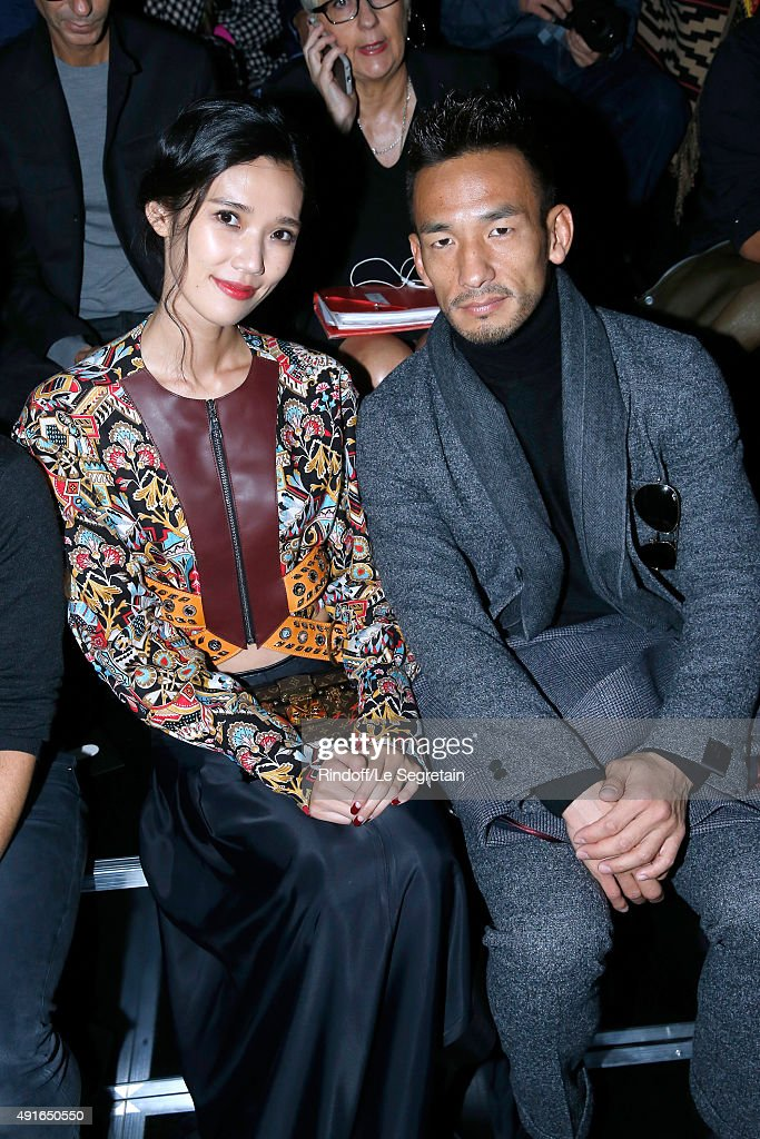 Model Tao Okamoto and Former Football Player Hidetoshi Nakata attend the Louis Vuitton show as part of the Paris Fashion Week Womenswear Spring/Summer 2016. Held at Fondation Louis Vuitton on October 7, 2015 in Paris, France.