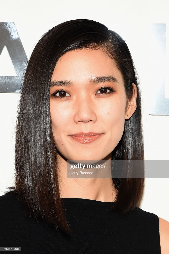 Model Tao Okamoto poses backstage at the Michael Kors fashion show during MercedesBenz Fashion Week Fall 2015 at Spring Studios on February 18 2015...