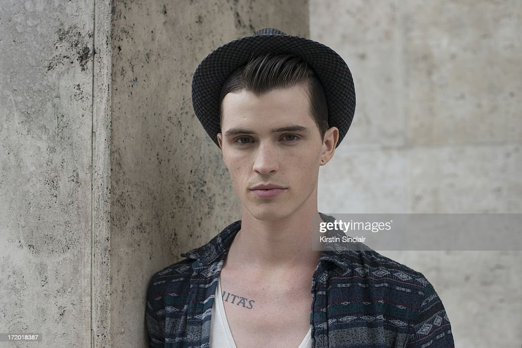 Model Taylor Cowan wears a vintage hat, H and M t-shirt, Topman shirt on day 3 of Paris Collections: Men on June 28, 2013 in Paris, France.