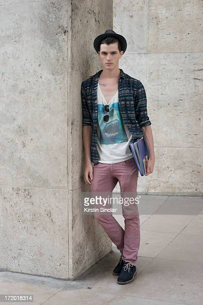 Model Taylor Cowan wears a vintage hat H and M tshirt Uniqlo jeans Topman shirt and shoes from Japan on day 3 of Paris Collections Men on June 28...