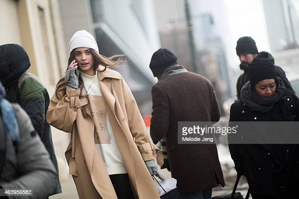 Model Taylor Hill exits the Ralph Lauren show in a 31 Phillip Lim coat and Acne Studios sweatshirt at Streets of Manhattan on February 19 2015 in New...