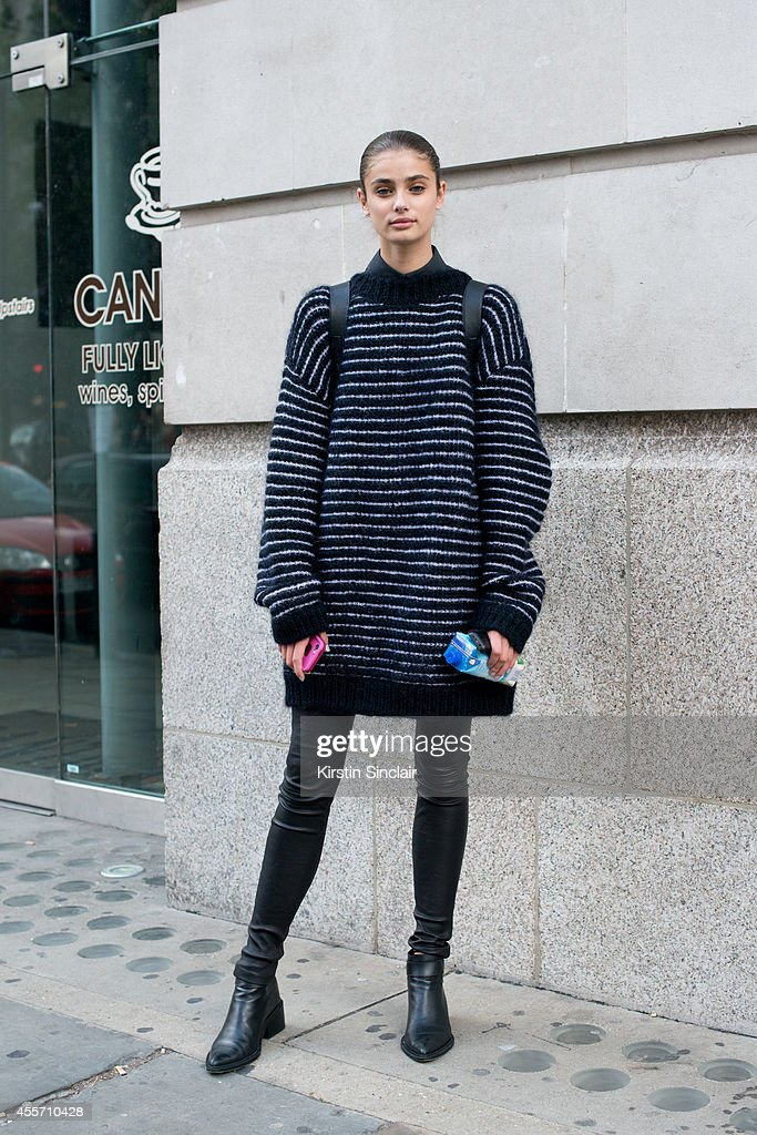 Model Taylor Hill is wearing an Acne sweater and Helmut Lang shoes and trousers on day 3 of London Collections: Women on September 14, 2014 in London, England.