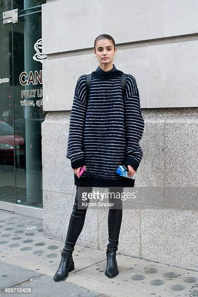 Model Taylor Hill is wearing an Acne sweater and Helmut Lang shoes and trousers on day 3 of London Collections Women on September 14 2014 in London...
