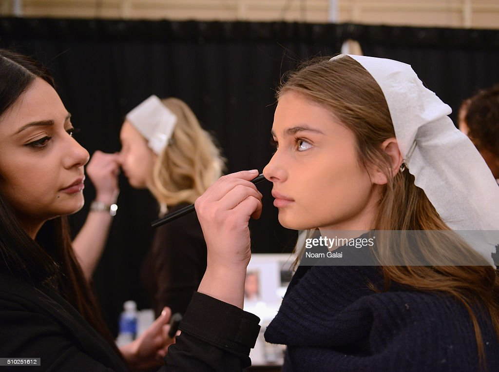 Model Taylor Hill prepares backstage at the Noon By Noor Fall 2016 fashion show during New York Fashion Week: The Shows at The Dock, Skylight at Moynihan Station on February 14, 2016 in New York City.