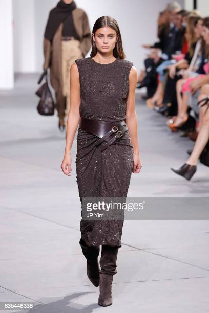 Model Taylor Hill walks the runway during the Michael Kors Collection Fall 2017 fashion show at Spring Studios on February 15 2017 in New York City