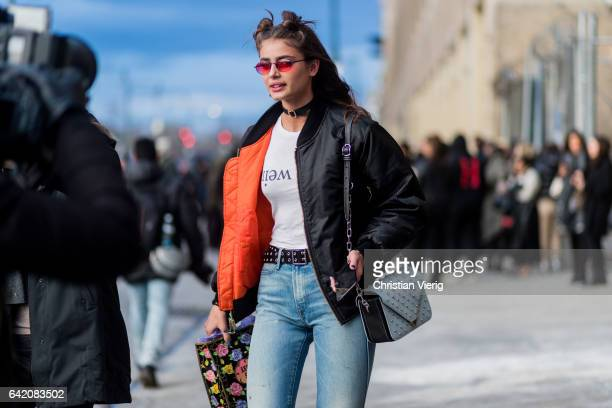 Model Taylor Hill wearing a black bomber jacket outside Anna Sui on February 15 2017 in New York City