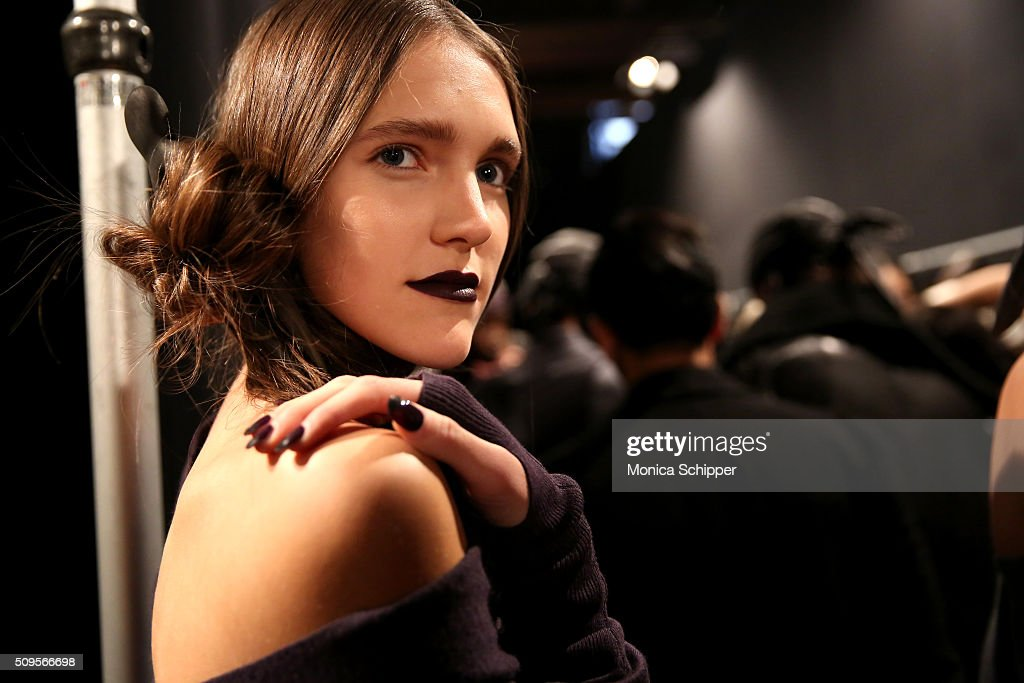 Model Taylor Reed prepares backstage at the Nicholas K Fall 2016 fashion show during New York Fashion Week: The Shows at The Dock, Skylight at Moynihan Station on February 11, 2016 in New York City.