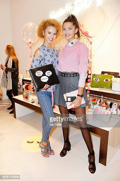 Model Taynara Wolf and model Fata Hasanovic attend the Iphoria store opening on December 6 2016 in Berlin Germany