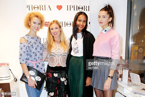 Model Taynara Wolf Milena Jaeckel CEO of Iphoria model Sara Nuru and model Fata Hasanovic attend the Iphoria store opening on December 6 2016 in...