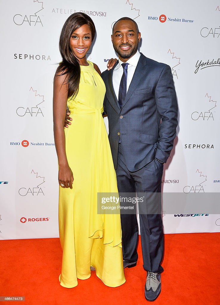 Model Tenika Davis and Actor Adrian Holmes arrive at the 1st Annual Canadian Arts and Fashion Awards at the Fairmont Royal York Hotel on February 1, 2014 in Toronto, Canada.