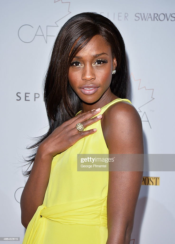 Model Tenika Davis arrives at the 1st Annual Canadian Arts and Fashion Awards at the Fairmont Royal York Hotel on February 1, 2014 in Toronto, Canada.