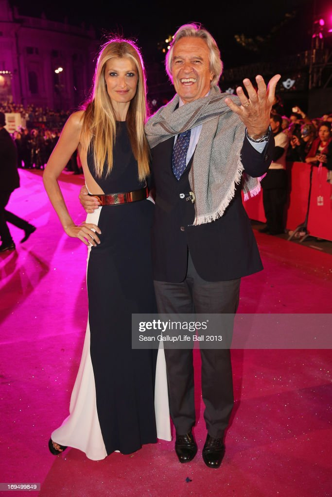 Model Tereza Maxova and jazz guitarist John McLaughlin arrive on the Magenta Carpet at the 2013 Life Ball at City Hall on May 25, 2013 in Vienna, Austria.