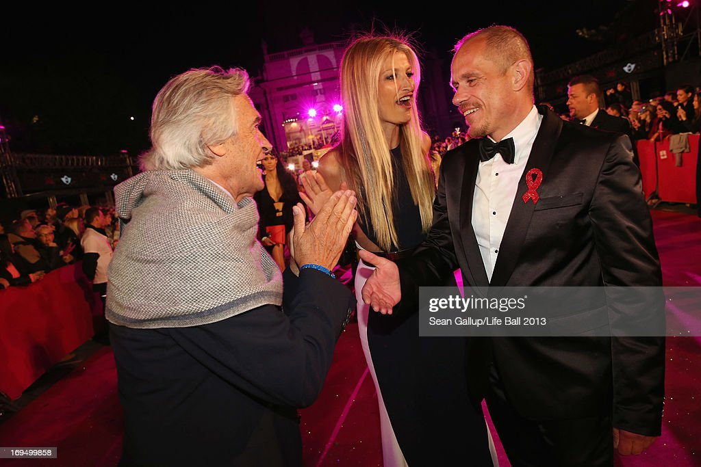 Model Tereza Maxova, jazz guitarist John McLaughlin and Gery Keszler arrive on the Magenta Carpet at the 2013 Life Ball at City Hall on May 25, 2013 in Vienna, Austria.