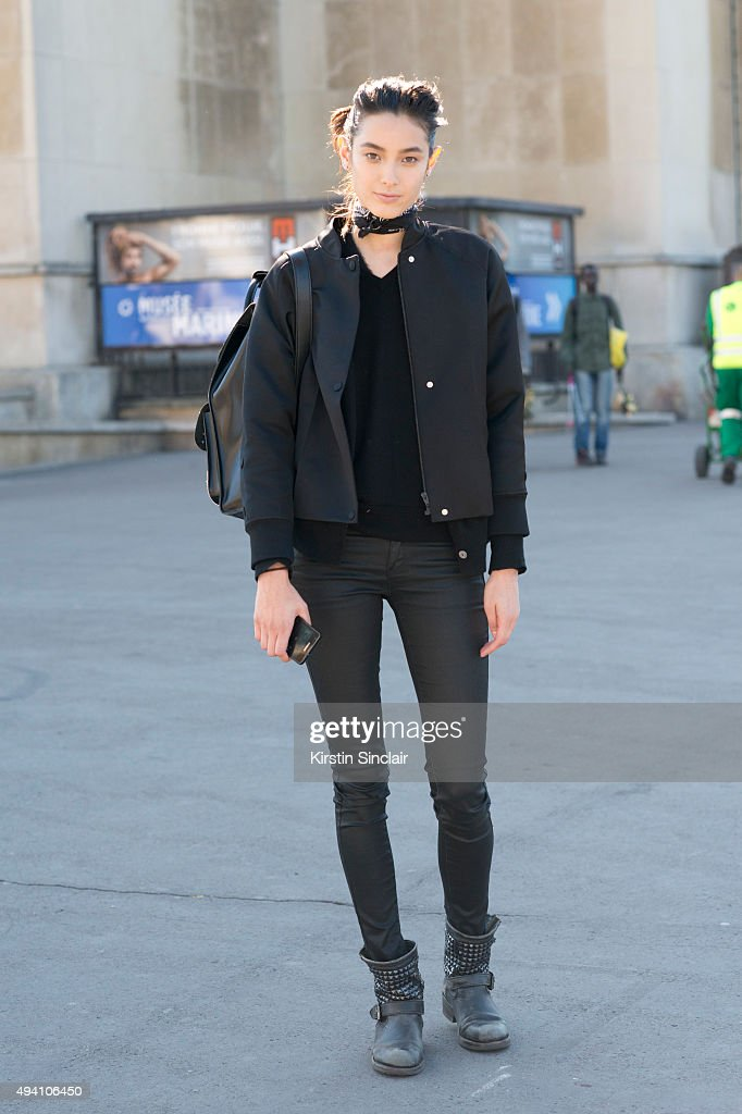 Model Tiana Tolstoi wears an Alexander Wang jacket Uniqlo trousers Ash bag and Doc Martin shoes on day 3 during Paris Fashion Week Spring/Summer...