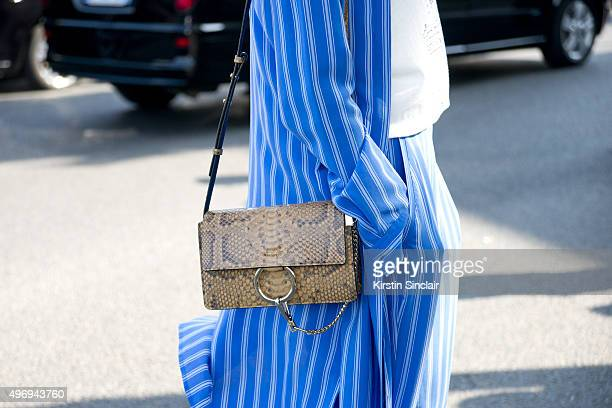 Model Tiffany Chenet wears a Closed top trousers and Chloe bag on day 6 during Paris Fashion Week Spring/Summer 2016/17 on October 4 2015 in Paris...