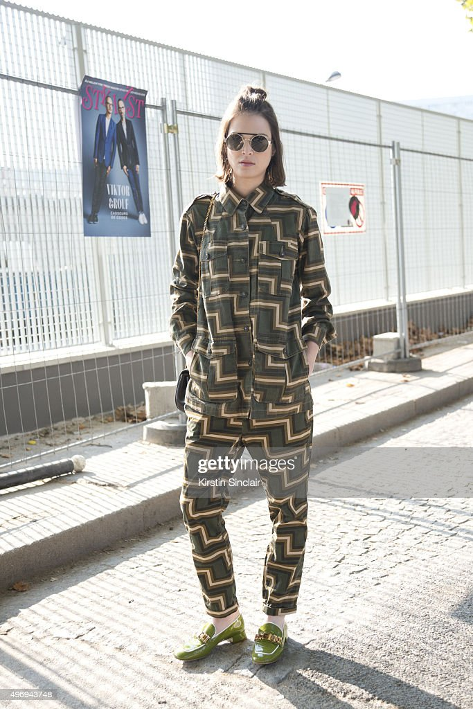 Model Tiffany Chenet wears Prada shoes Closed top and trousers Sandro sunglasses and Chloe bag on day 6 during Paris Fashion Week Spring/Summer...