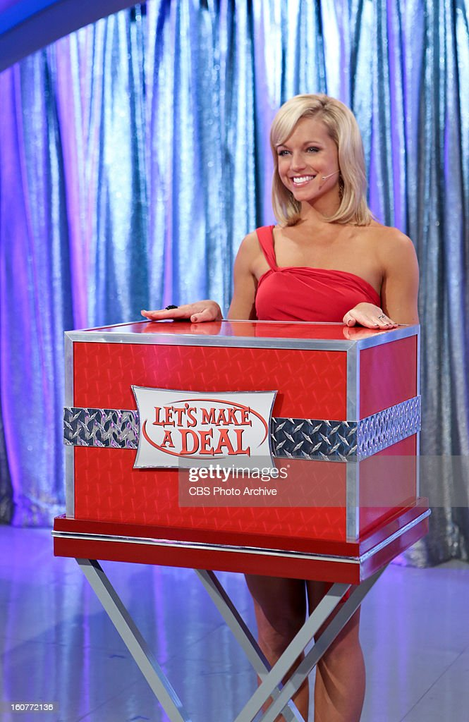 Model Tiffany Coyne waits for her cue to unveil what'™s in the box, on a special Valentines Day episode of LET'S MAKE A DEAL, Thursday, Feb. 14 (check local listings) on the CBS Television Network.