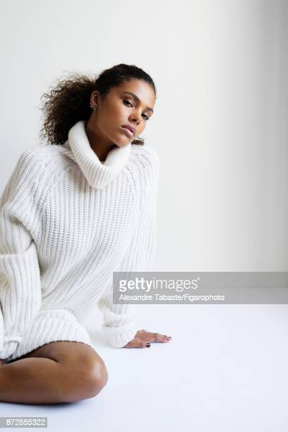 Model Tina Kunakey are photographed for Madame Figaro on September 11 2017 in Paris France Sweater dress earrings personal PUBLISHED IMAGE CREDIT...