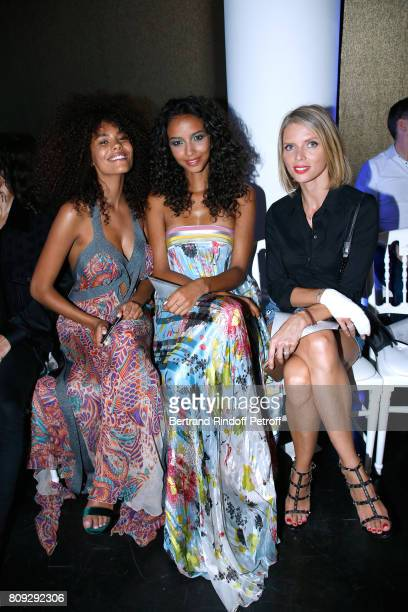 Model Tina Kunakey Miss France 2014 Flora Coquerel CEO of Miss France Company Sylvie Tellier attend the Jean Paul Gaultier Haute Couture Fall/Winter...