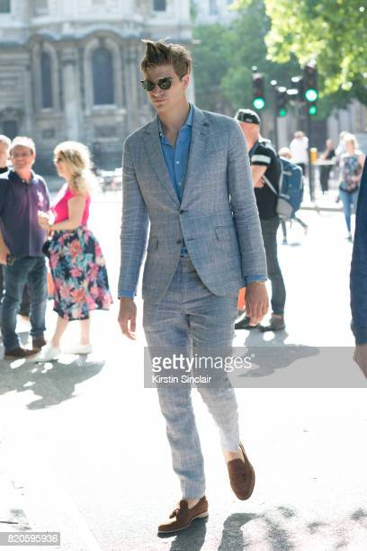 Model Toby Huntington Whiteley wears a Hackett shirt and suit Loake shoes and Fendi sunglasses on day 3 of London Collections Men on June 11 2017 in...
