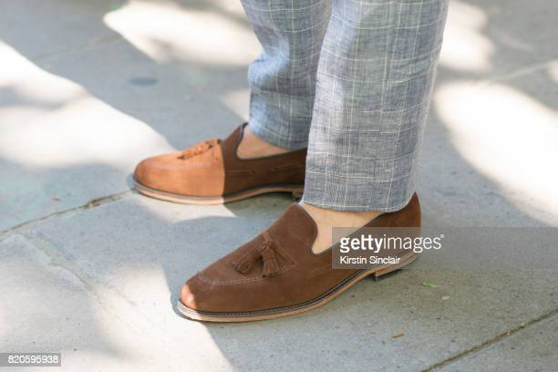 Model Toby Huntington Whiteley wears a Hackett suit and Loake shoes on day 3 of London Collections Men on June 11 2017 in Paris France