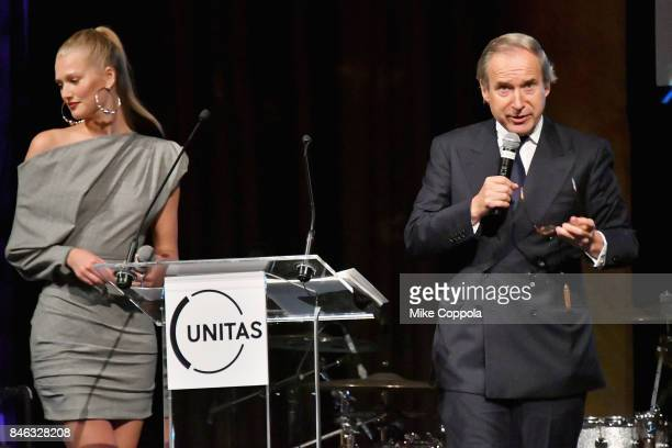 Model Toni Garrn and auctioneer Simon de Pury speak onstage during Unitas Third Annual Gala Against Human Trafficking at Capitale on September 12...