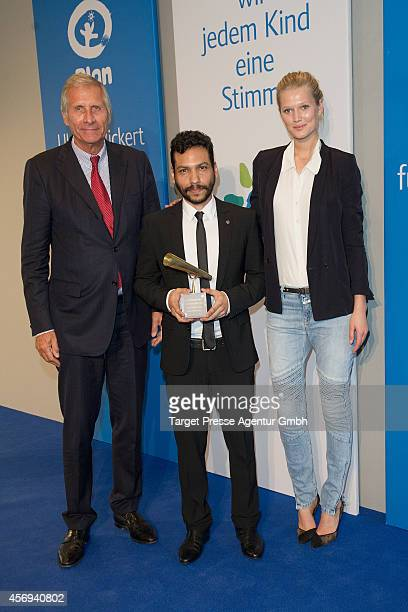 Model Toni Garrn award winner Jose Enrique Rojas and Ulrich Wickert attend the Ulrich Wickert Award for children's rights at Hamburger Bahnhof on...