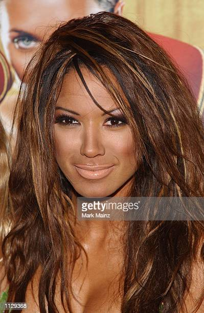 Model Traci Bingham poses at the launch of 'PETA's BareAll Summer Campaign' July 11 2002 at Suite 16 in New York City Traci Bingham features in the...