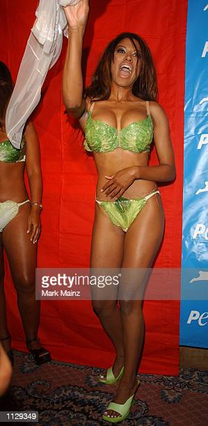 Model Traci Bingham wears a lettuce bikini at the launch of 'PETA's BareAll Summer Campaign' July 11 2002 at Suite 16 in New York City Traci Bingham...