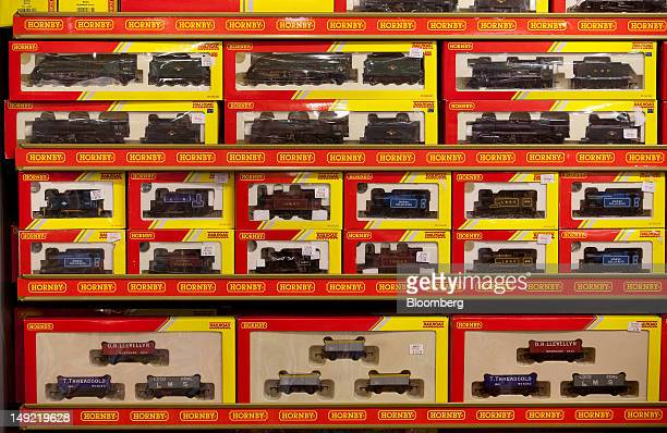 Model train sets produced by Hornby Plc sit on display at Hamleys Plc's flagship toy store on Regent Street in London UK on Wednesday July 25 2012...